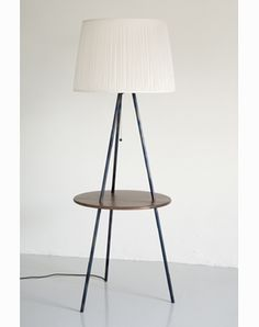 The Leading Light A floor light with a difference - it has a walnut shelf for your drink or book. Shown here with a drum shade Tripod Floor, Lamp, Wooden Floor Lamps, Floor Lamp, Walnut Shelves, Flooring, Floor Lights, Furniture Design, Timeless Furniture
