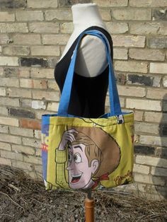 Buzz Lightyear Space Adventurer and Woody Cowboy Roundup Handbag Blue Yellow Brown White Green and Red. £12.00, via Etsy.