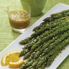 Asparagus with Zesty Citrus Dressing: An orange mustard dressing adds a burst of flavor to springtime-fresh asparagus. The toasted sesame seeds add the final touch. Courtesy of McCormick Gourmet.
