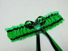Black satin with emerald green satin trim with organza backing in emerald green. Black and emerald green satin ribbon bow with Hulk Face in the centre. Green Satin, Black Satin, Hulk Superhero, Wedding Garter, Wedding Day, Prom Dresses, Garter Belts, Emerald Green, Wedding
