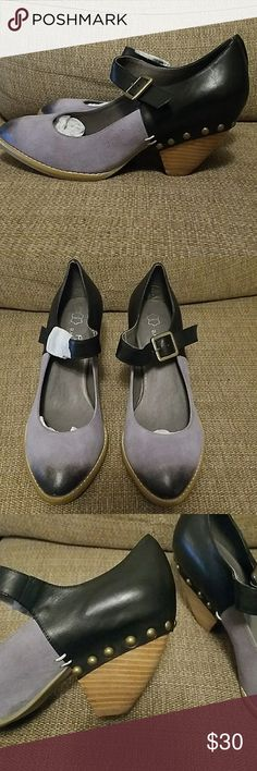 """NWOB black and purple wedge heels Never worn black and light purple color-blocked heels with wooden wedge heel and bronze button details. Purple section is suede, black is leather. Super cute with a dress or jeans, these have a vintage look. 2"""" heel. Encore Shoes Heels"""