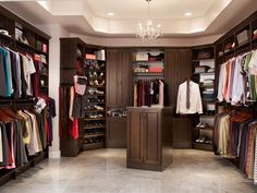 Walk In Closet by Closet Maid.  I was pleased to see Closet Maid has started carrying more versatile, effective pieces. I strongly dislike the corner units they sell, and urge you NOT to design a closet with these ridiculously inefficient towers.  LauretteOwenby/HouseOrganized.com