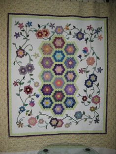 Inspiration only. Photos on blog. This is a large bed quilt done over three years. I love that it uses hexies, but it doesn't have that patchwork feel. 1 More Stitch: Grandmother's Flower Garden
