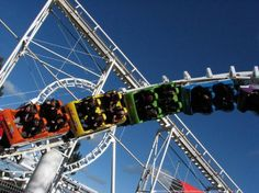 Corkscrew, Rainbow's End, New Zealand. How about that color scheme on a coaster train? New Zealand North, Great Memories, Roller Coaster, Auckland, Rainbows, Places Ive Been, Tourism, Train, Island