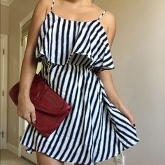 """Black and white flirty striped dress NWT Flirty striped dress.   Elastic waist cutout back  and adjustable straps , bottom dress is lined , 100% Polyester , Fits Junior Size. I am 5'3"""" 120 lbs 34C Bust .  I model a size Medium. Dresses"""