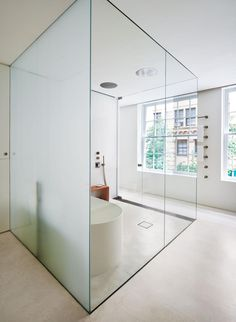 Etched and clear #glass in this luxurious #bathroom. #design