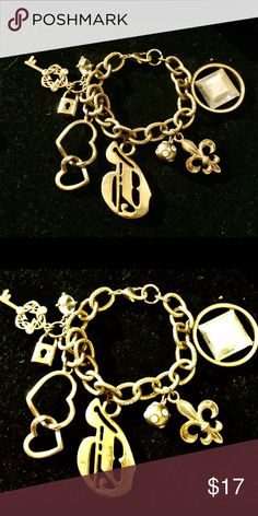 GUESS JEWELED CHARM DANGLES BRACELET Some charms has jewels. Box not included. Guess Jewelry Bracelets