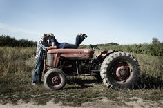 Ferguson's Orchard tractor engagement picture