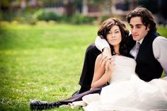 Wedding Bride and Groom Poses | Bride and groom sitting on the ground cuddling together. Wedding ...