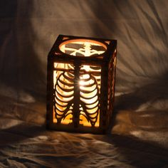 Tea light luminary made of laser cut wood.    Rib Cage design converted from original drawing.    Hand crafted and designed in Seattle, Washington.