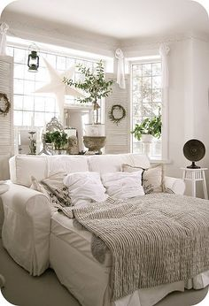 So cozy, great idea! Love the mix of green and white, love the sofa too!