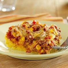 Cornbread base topped with beef, zesty tomatoes, corn, and cheese for a flavorful baked entree- looks good, use ground turkey - it's low fat