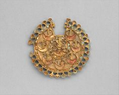 Earring Period: Achaemenid Date: ca. 6th–4th century B.C. Geography: Iran Culture: Achaemenid Medium: Gold, turquoise inlay Dimensions: 0.3 × 0.35 × 6 cm, 31.08g (1/8 × 1/8 × 2 3/8 in., 1.096oz.)