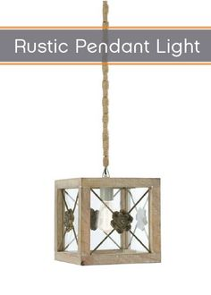 Shine a stylish, rustic light on any room with this stunning pendant light. Adorned with brass rosettes and a square distressed wooden frame, this light fixture will add elegance to your home.