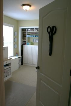 I will be sharing a door with the laundry room, but I like this idea of the gigantic scissors on the door! :D Simplicity in Storage {Nicole Heady}