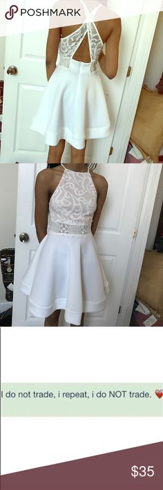 Flare dress Only worn once, features a criss cross back and lace detailing throughout the front and back. No stains that i can spot at the moment Dresses Mini