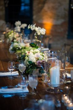 Love this tablescape with pillar candles, garden style centerpieces, on a farm house table. Romantic wedding, wedding inspiration, Baltimore weddings, Maryland weddings. Photo Credit: Artful Weddings by Sachs Photography #weddingvenue #venues
