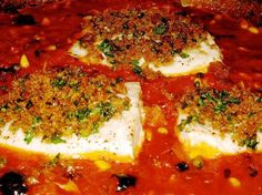 Swordfish Baked in Tomato Sauce with Crunchy Breadcrumbs. Good and easy, could do with chicken or other kinds of fish. I like that its a one dish meal.