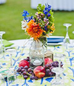 Nectarine and Grape Table Decor | 11 Gorgeous Centerpieces With Fruit | https://www.theknot.com/content/11-gorgeous-centerpieces-with-fruit