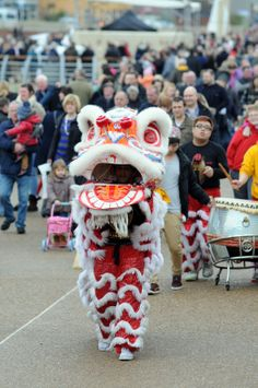 Chinese Dragon dancers at Littlehaven opening day, South Shields, South Tyneside.