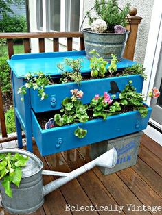 I love this use of an old desk or dresser as a planter. It really makes this balcony garden feel unique.