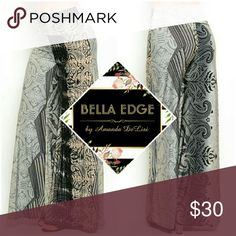 """Black gray filigree palazzo wide leg pants 92% NYLON, 8% SPANDEX. MADE IN USE. This cute and trendy palazzo style pants features a slim, stretch fit with allover fancy filigree pattern print and a fold-over waist band in """"goes with everything"""" black/gray with cream accents. Sizes small to large.  Ships Thursday 7/8 Bella Edge Boutique  Pants Wide Leg"""