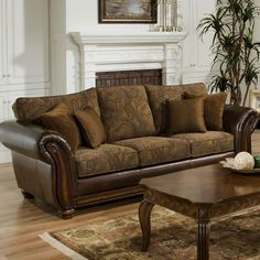 Pairing bonded leather arms with paisley-printed upholstered pillows, this sophisticated sofa brings a new touch of style to a traditional design. Set it in the living room with a Persian rug and still life art for a classic aesthetic.