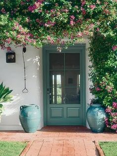 similar color scheme: grey-white house, blue-green trim/ accent color, pink or purple flowers in front yard