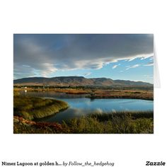 Nimez Lagoon at golden hour The idyllic Nimez Lagoon at golden hour. Surrounded by reeds and topped by a cloudy sky. Remarkable reflection and precious light for this wide panorama. The picture was taken in El Calafate, Argentina Blue Poster, Blue Gift, Everywhere You Go, Make Your Own Poster, Modern Artwork, Golden Hour, Continents, Picture Wall, Reflection