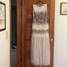 Beautiful long / short maxi dress This dress was worn once and is in mint condition. It is long and flowing On outside and has a mini white skirt on the inside. It is beautiful with  purple flowers on the top . It is one of a kind. More pictures available if seriously interested.It has a slightly padded bra inside. Angel-fashions Dresses