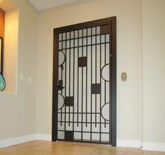 'Avery' design - wrought iron security door for interior elevator