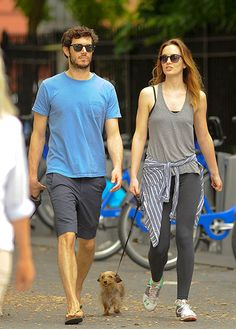 Both rocking chic black shades, Adam Brody and wife Leighton Meester took their dogs for a walk on July 17 in New York City.