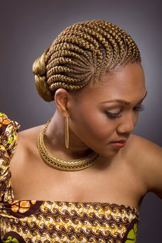Golden Twisted Cherokee - an original of Senegal, W. African this style puts a spin on the typical braid with a twist and turn in each braid.  This is a way of having a lighter color without dying your own hair for a brighter spring look.