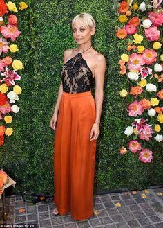 Stunning starlet: Nicole looked lithe in the high-waisted silk trousers and lace top...