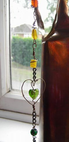 Copper Rainbow - a long suncatcher in glass beads and copper wire by Sneddonia, via Flickr