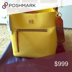 """💯%AUTHENTIC Dooney&Bourke Large Roxy Bag, Leather NWT LARGE ROXY HANDBAG, nothing small about this Dooney&Bourke!  Beautiful in Yellow with some Brown leather trimmings, gold tone hardware, H 12""""x W 7""""x L 14"""", magnetic closure, Large zip pkt on front, interior has 2 Large zip pkts, 2 Large slit pkts, Adjustable, detachable twill strap, Strap drop length approx 22.75"""", looking for a SMALL bag? Then this bag is not for you💕👍🏻 Comes w/dust bag, tags attached💋❌PRICE FIRM❌ Dooney & Bourke…"""