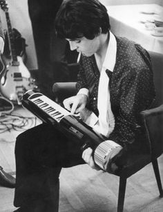 Paul McCartney fiddles around with an ancestor of the keytar, The Tubon, backstage at a gig in Germany.