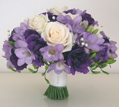 Bouquet of cream roses, lilac freesias and lisianthus in shades of purple