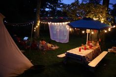 A campout/outdoor movie party. - I've wanted to do this for years. NEED that projector!.... oh, and a yard. lol
