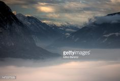 Early morning landscape with clouds, mountains range with fog at... #iselsberg: Early morning landscape with clouds, mountains… #iselsberg