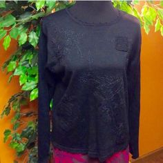 🌸BLACK SWEATER BY ERIKA🌸 Sweet black sweater with embroidery and crotchet detail on the front.. Like new Erika Sweaters