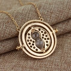Harry Potter Necklace Time Turner Item Type: Pendants Fine or Fashion: Fashion Style: Classic Gender: Women Pendants Type: Solitaire Material: Metal Metals Type: Zinc Alloy Shape\pattern: Round Model