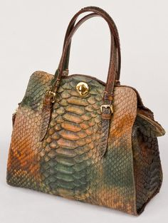 https://www.cityblis.com/10436/item/11952 | Positano - $2800 by Retta Wolff | Unique shoulder bag with twist closure. Gold tone decorative hardware. Double carrying handles. Suede type Interior with a zippered pocket and two side pockets. Shown in Alicante King Python. Can be Special Ordered in any Skin Color.                                             Dimensions 12 1/2&quo... | #Handbags/Purse