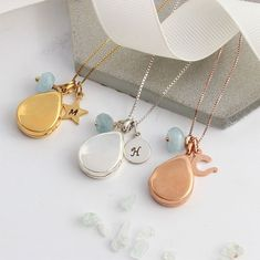 modern teardrop locket in silver, rose gold or gold vermeil. Personalised with an initial charm and aquamarine for a March birthday gift