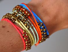 Google Image Result for http://pumpsandiron.files.wordpress.com/2012/07/diy-neon-braided-bead-bracelet-4.jpg