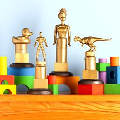 Homemade Trophies for Kids. Use figurines, paint, Krazy Glue, and plain plaques (or wood blocks) to create these simple, homemade trophies.