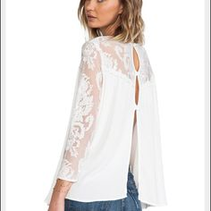 For Love and Lemons White Lace Blouse Beautiful flowy blouse with lace neckline and sleeves. Back is open with two buttons. Bottom of lace neckline has a tiny Pom Pom like border. Very rare top. No damage. No trades For Love and Lemons Tops