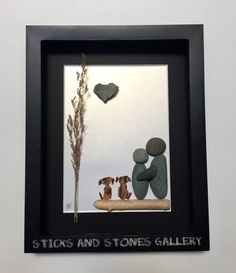 Our personalized couples pebble art gifts and original stone art designs are made with a variety of beach treasures from the beautiful beaches of Vancouver Island, Canada. Showcased in an 8 X 10 X 1 inch black shadow box frame is a stone couple, that are catching a quiet moment together with their two beloved dogs. Truly a whimsical, peaceful scene. The beach stones, some a delicate dried grass, and driftwood give the piece a nautical feel. A unique heart shaped rock makes this piece extra…