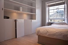 Chepstow Road, Notting Hill by Ardesia Design. Custom made joinery in the bedroom with LED lights #joinery #custom #made #bedroom #wooden #floor