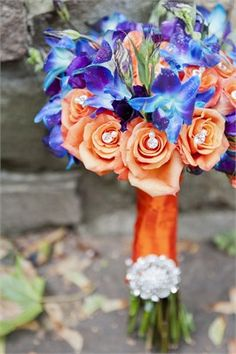 orange and blue wedding flowers----not really a fan of the orange but the blue is to die